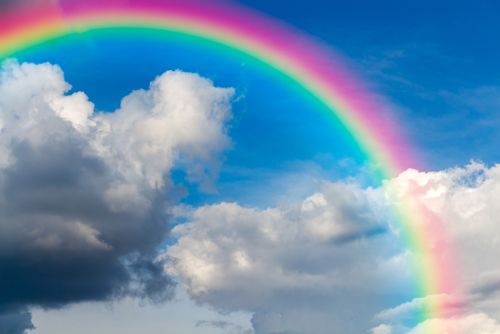 Blue,Sky,And,White,Cloud,With,Sun,Light,And,Rainbow